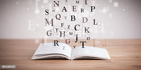 istock Opened book with flying letters 934095302