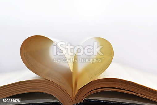 503130452istockphoto Opened book with heart form sheets. 670534928