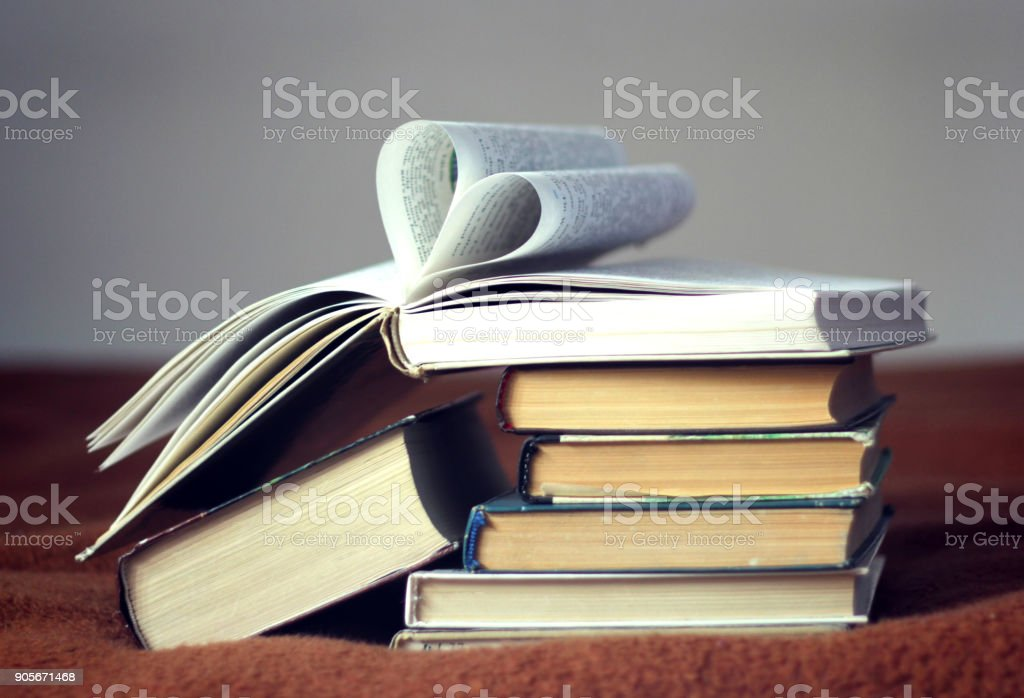 Opened book with heart shaped pages stock photo