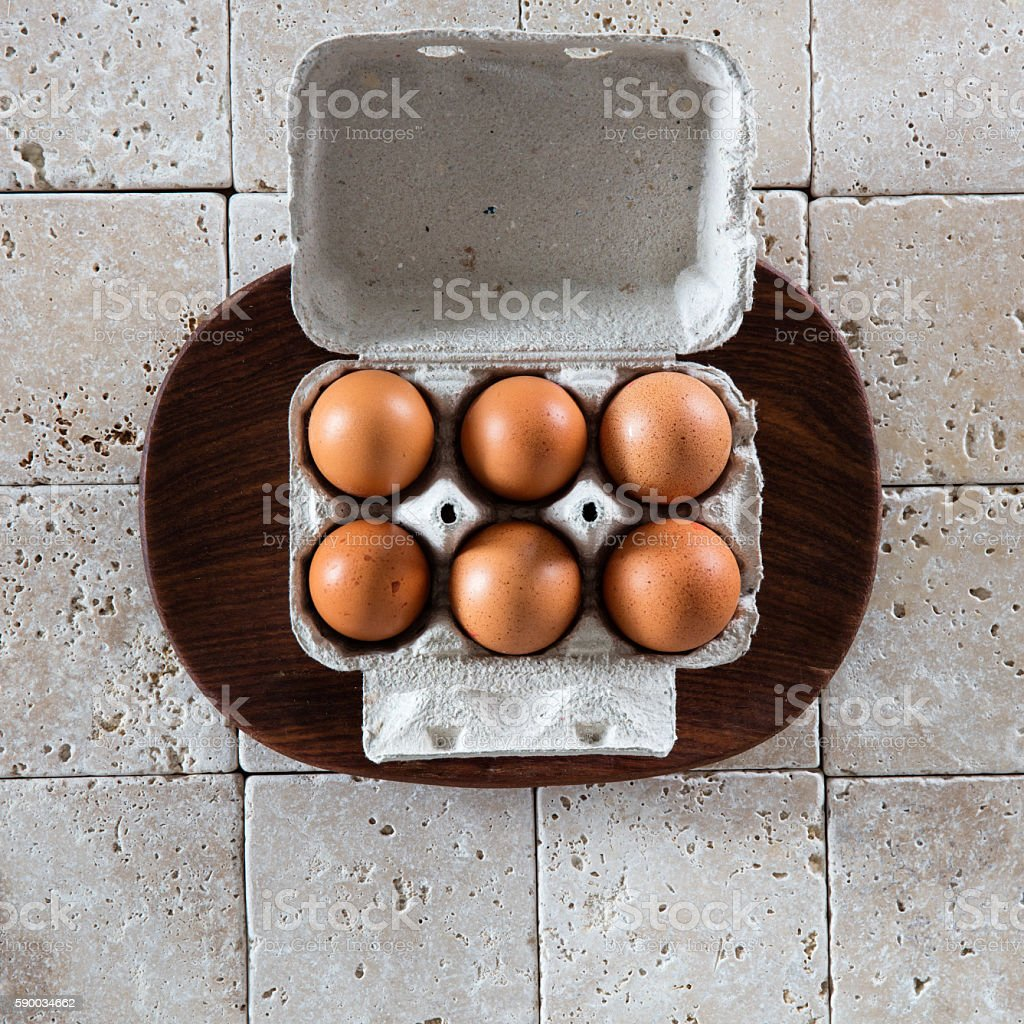 opened box of six brown eggs for expensive food concept stock photo