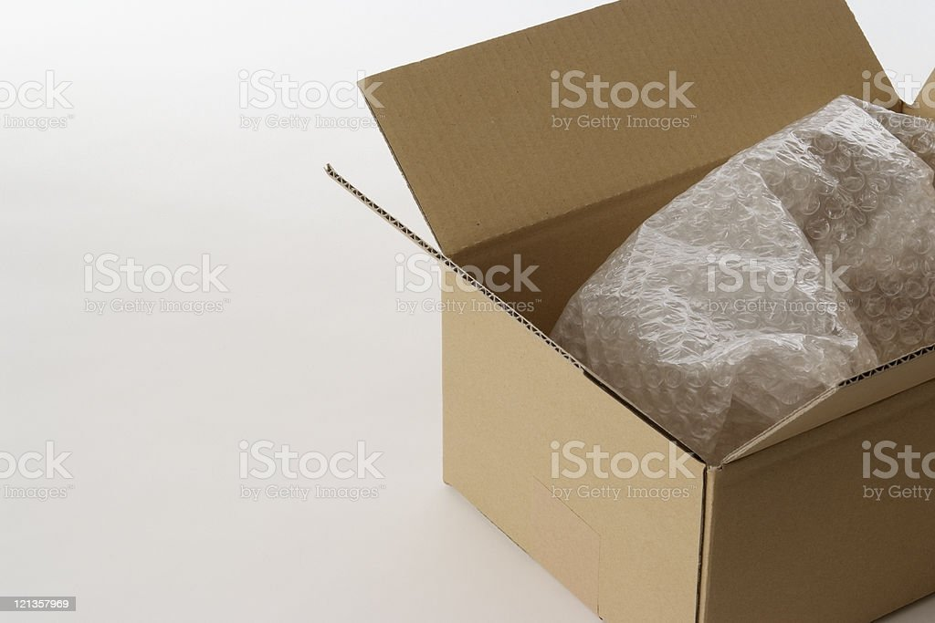 Opened cardboard box with shock absorbing material royalty-free stock photo