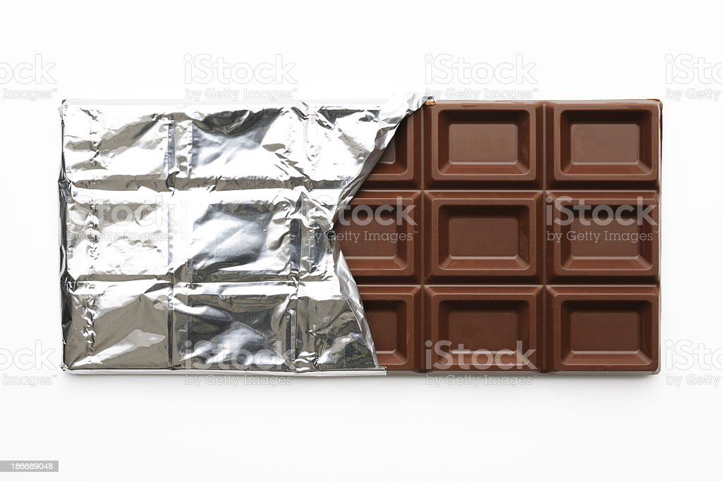 Opened chocolate bar's silver foil on white background stock photo