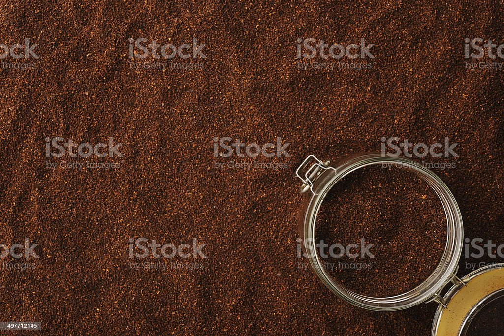Opened coffee container on ground coffee beans with copy space royalty-free stock photo