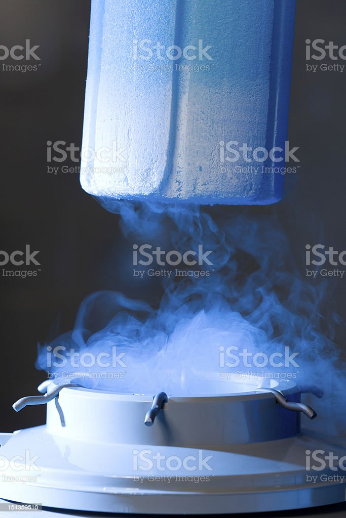 Opened container with liquid nitrogen, blue light stock photo