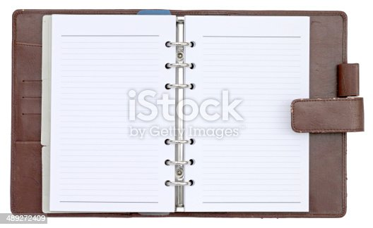 istock Opened cover notebook isolated on white background 489272409