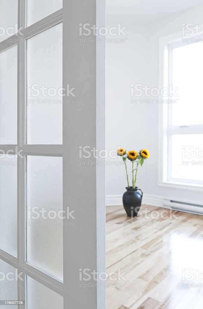 Opened door leading into a room full of light royalty-free stock photo