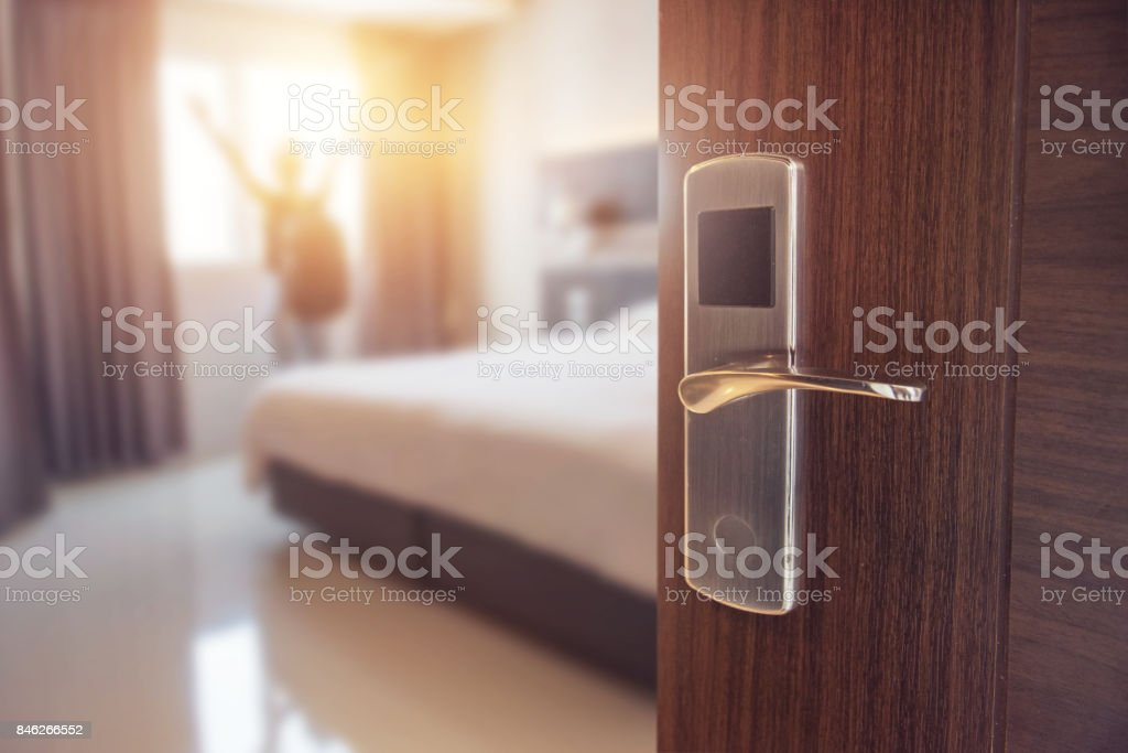 Opened door of hotel room in morning stock photo