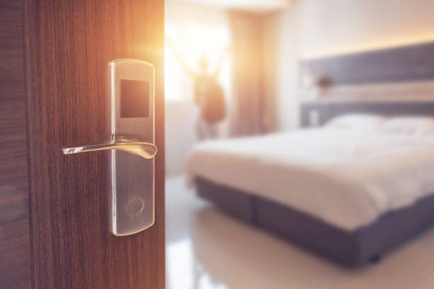 Opened door of hotel room in morning Opened door of hotel room in morning with background blurred happy backpacker traveller stay in hotel, copy space, sunlight effect. luxury hotel room stock pictures, royalty-free photos & images