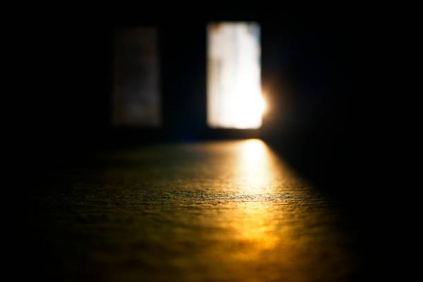 Opened door with sunset light leak background hd stock photo