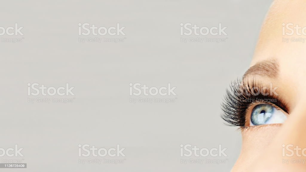 Eyelash extensions, make-up, cosmetics, beauty background with copy...