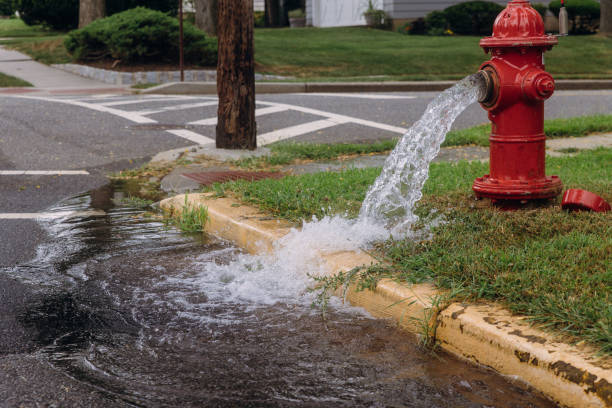Opened fire hydrant later leak spray Opened fire hydrant later leak spray in residents open fire hydrants fire hydrant stock pictures, royalty-free photos & images