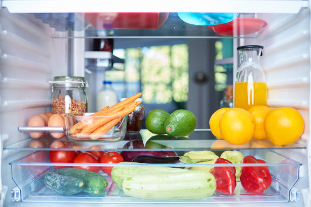 Opened fridge from the inside. Opened fridge from the inside full of vegetables, fruits and other groceries. fridge stock pictures, royalty-free photos & images