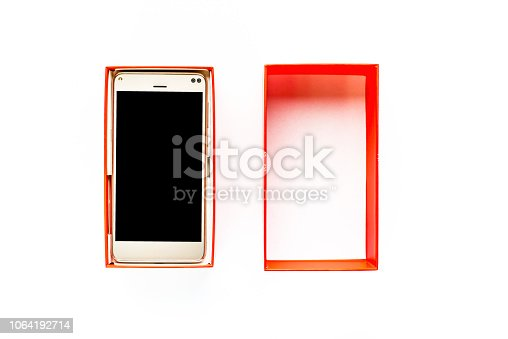 1161116588istockphoto Opened gift box with smartphone, black screen, elegant mobile phone isolated on white background 1064192714