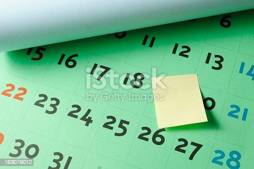 Close-up of a sticky note on a calendar.