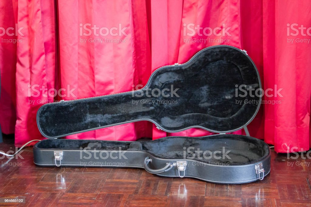 opened guitar case on stage royalty-free stock photo