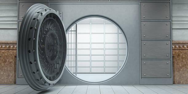 Opened huge empty bank vault front view stock photo