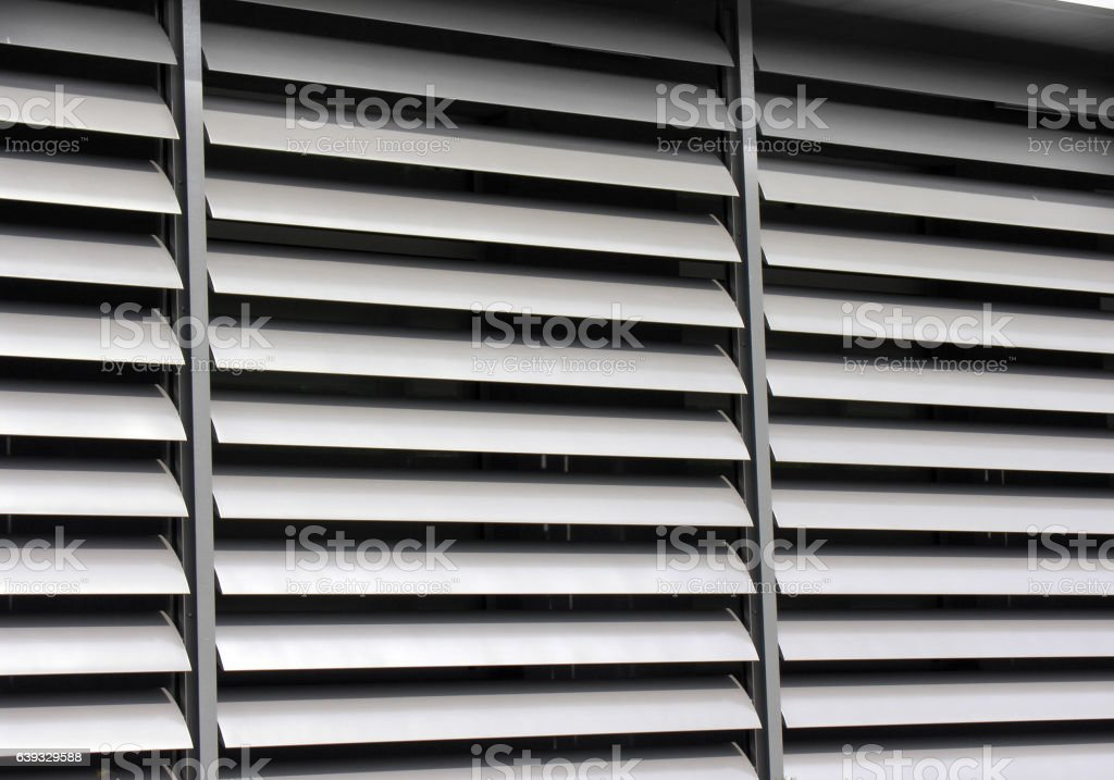 opened metallic  window shutter at the  office building stock photo