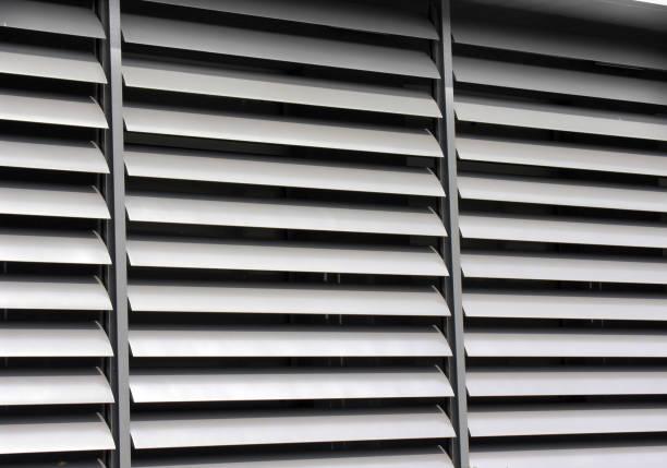 opened metallic  window shutter at the  office building - com portada imagens e fotografias de stock