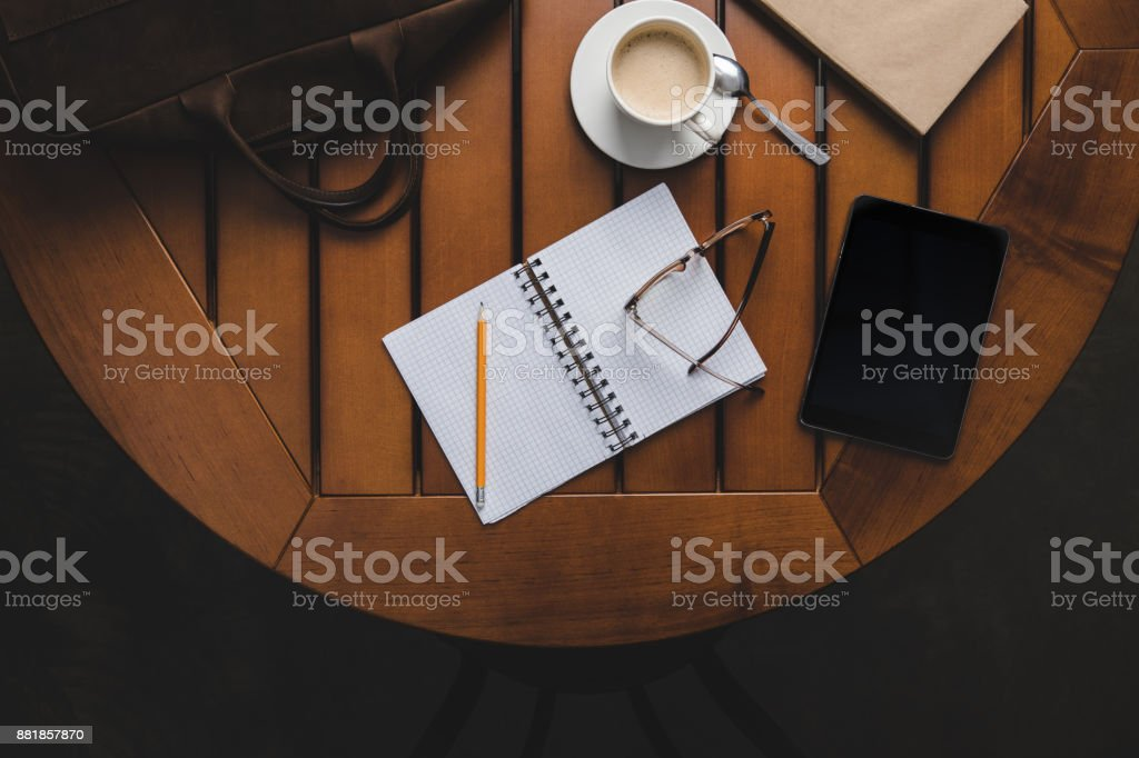 opened notepad and tablet stock photo