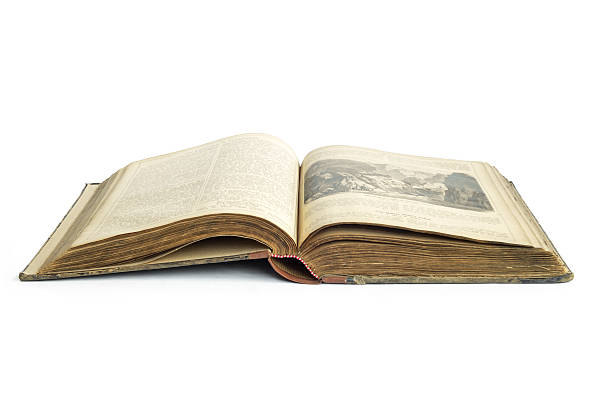 Opened old ancient book with isolated background stock photo