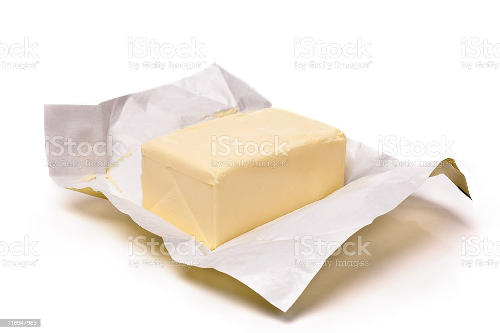 Opened packaging of salted butter on white background royalty-free stock photo