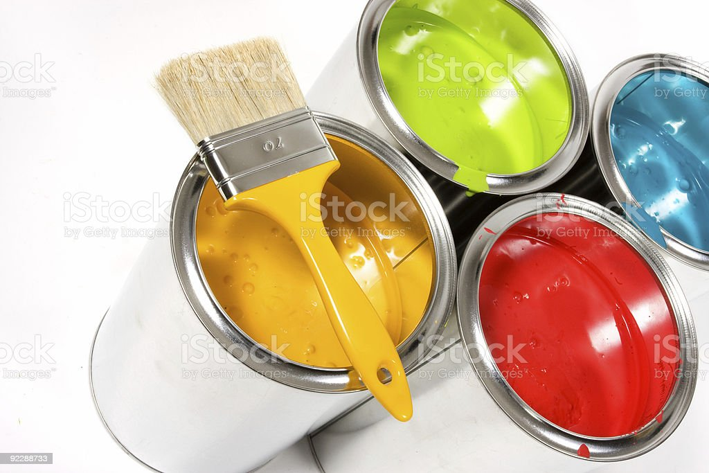 Opened paint buckets colors with paintbrush stock photo