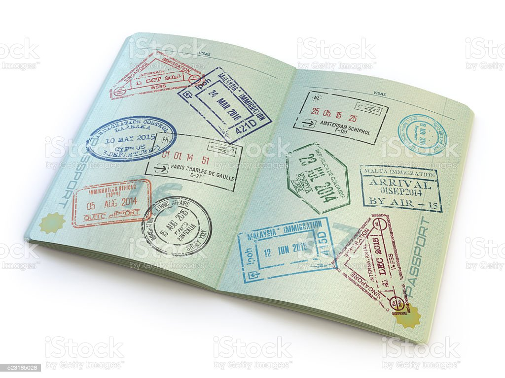 Opened passport with visa stamps in the  pages stock photo