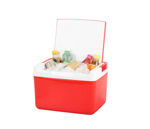 Opened red cooling box with bottles of beverage and ice isolated stock photo