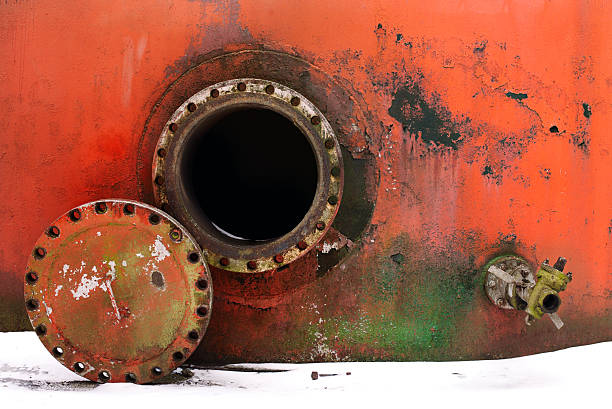 opened rusty manhole opened rusty manhole on the red fuel tank confined space stock pictures, royalty-free photos & images