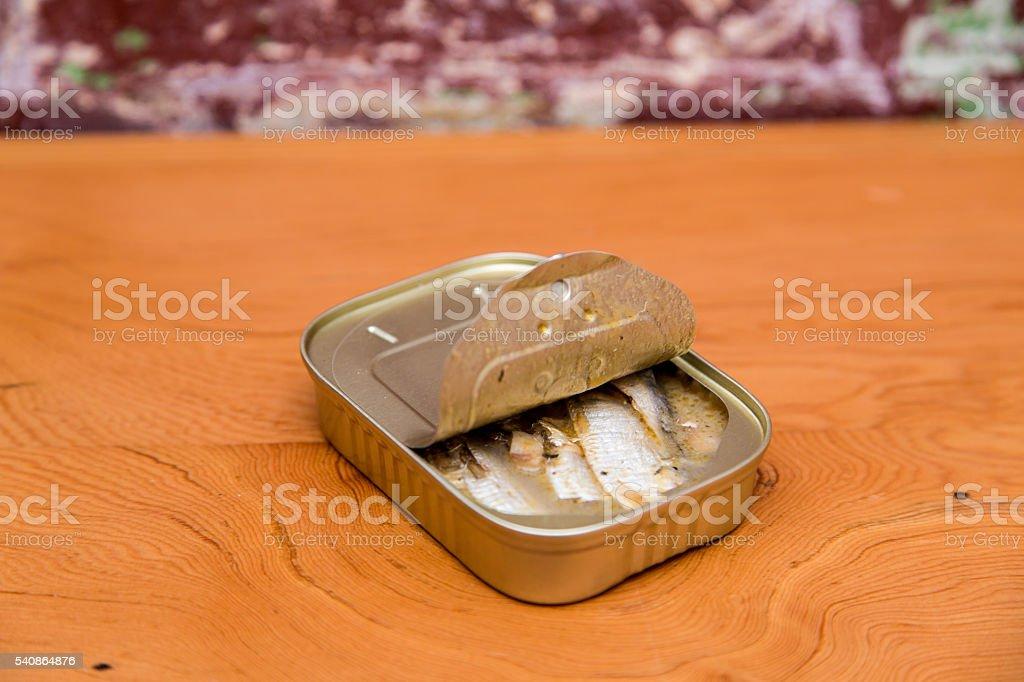 Opened Sardine Tin on Wooden Table stock photo