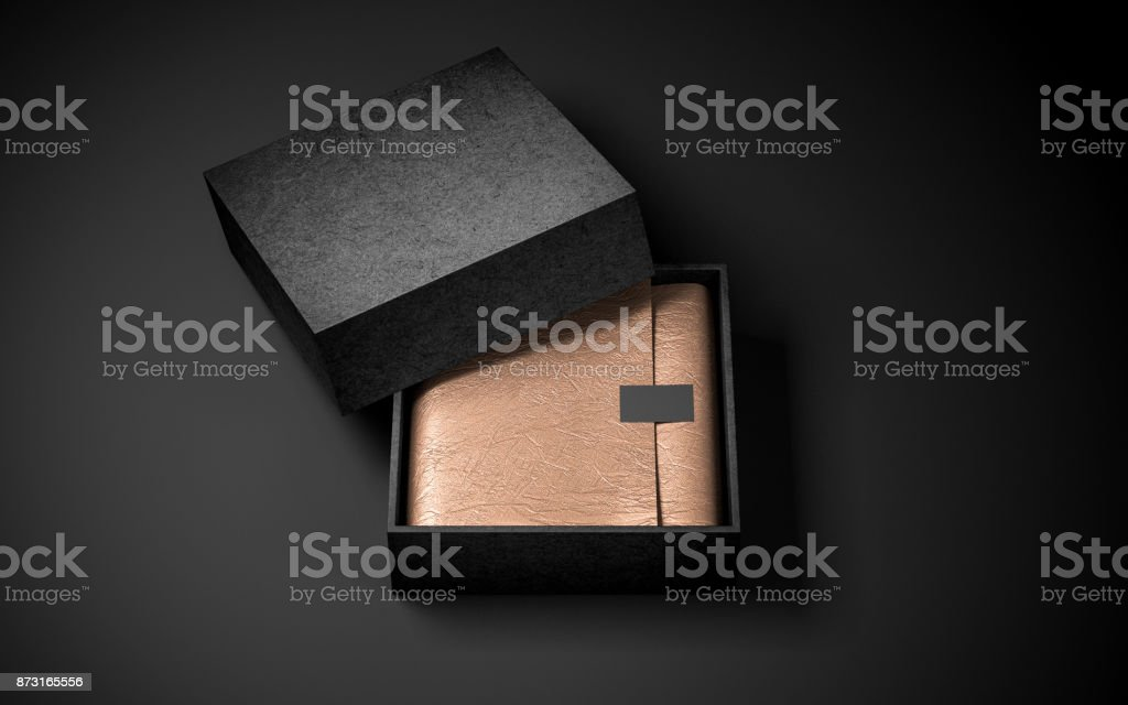 Opened Square Black Box with Golden wrapping paper and label sticker stock photo