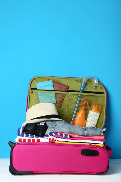 Opened suitcase with clothes camera and sunscreen bottles on wooden picture id1041714518?b=1&k=6&m=1041714518&s=612x612&w=0&h=hvrqkqe gkq9i rskbjc9itptjgj7yaxca60zt6v1c4=