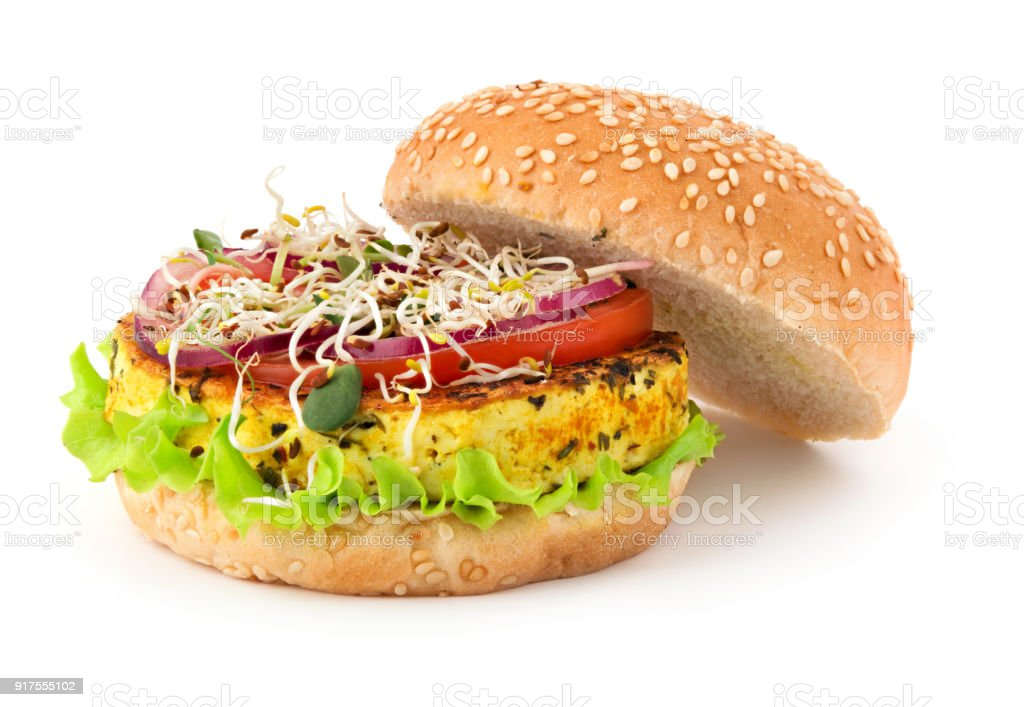 Opened vegan burger with grilled tofu cheese, vegetables and micro greens isolated on white background stock photo