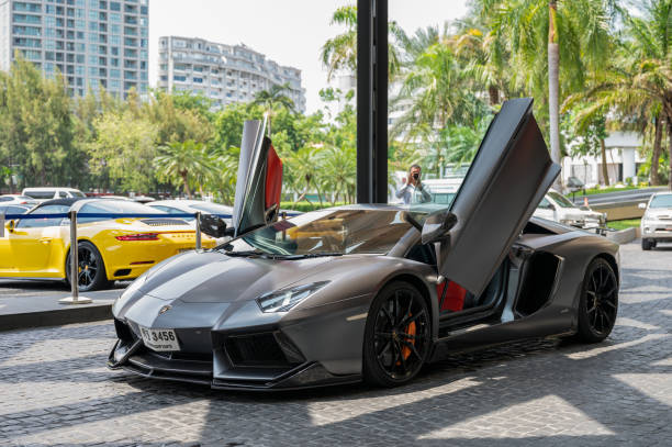 Opened vehicle door of Dark Lamborghini sport cars of famous brand parking on front of the Royal Cliff Beach Hotel Pattaya, Thailand - May 26 2019 : Opened vehicle door of Dark Lamborghini sport cars of famous brand parking on front of the Royal Cliff Beach Hotel ferrari stock pictures, royalty-free photos & images