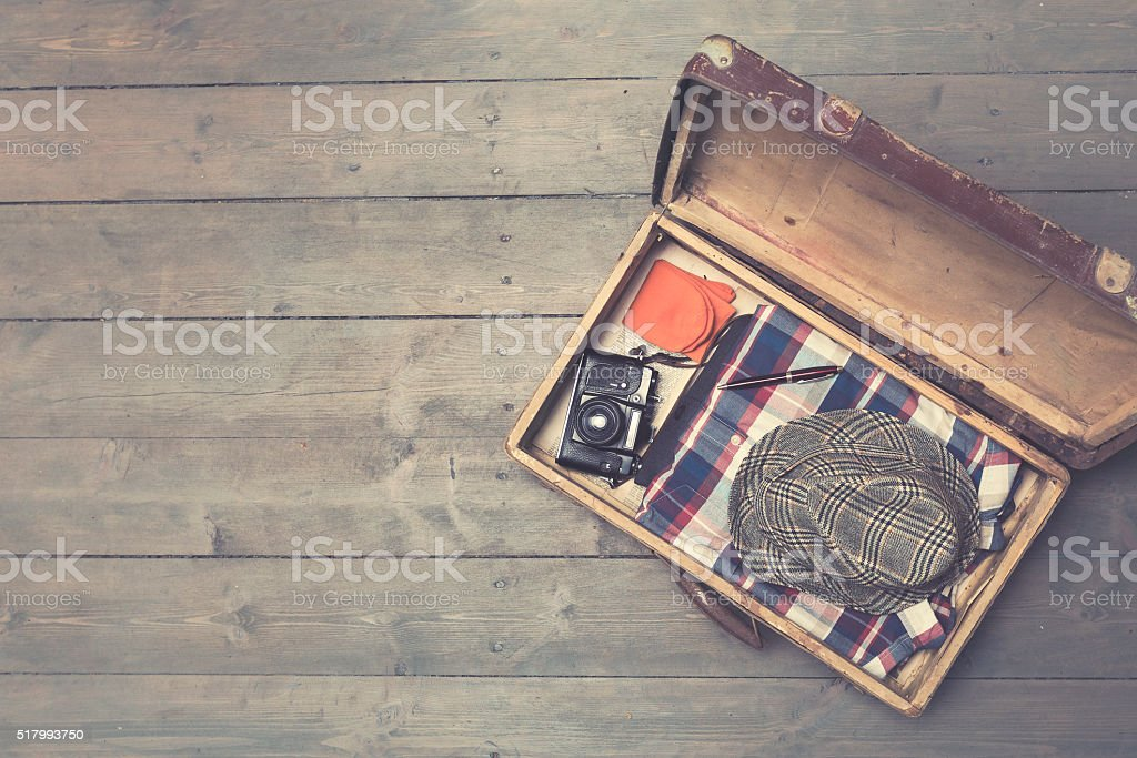 opened vintage suitcases with clothes and accessories stok fotoğrafı