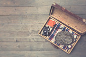 opened vintage suitcases with clothes and accessories