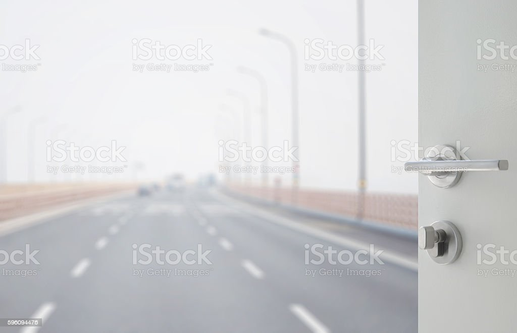 opened white door to highway with three curve lanes. Lizenzfreies stock-foto