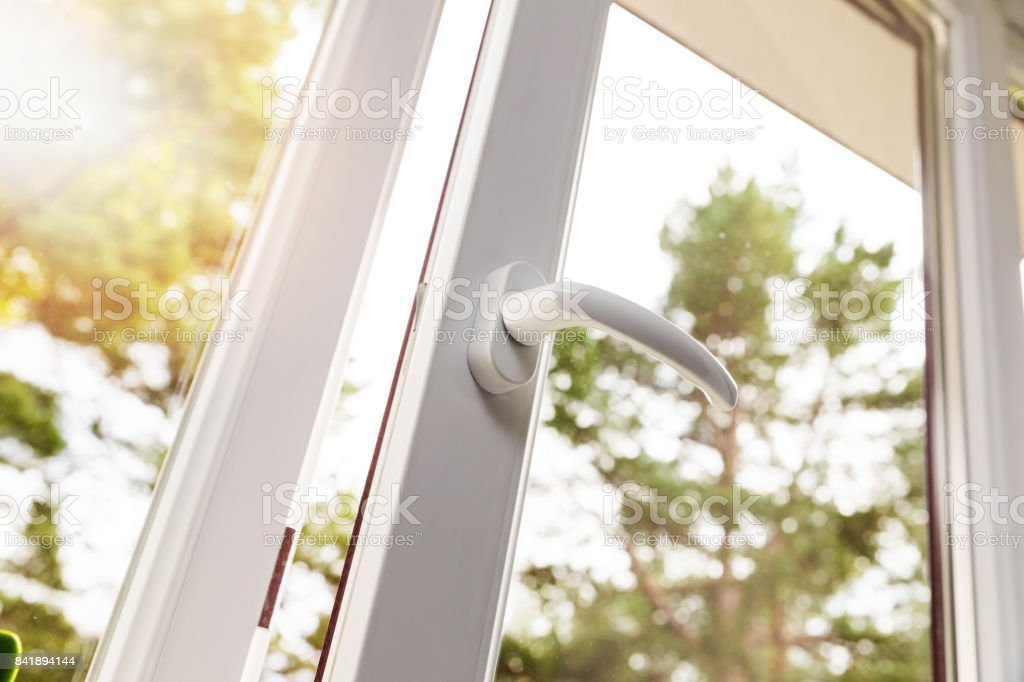 opened white plastic pvc window stock photo