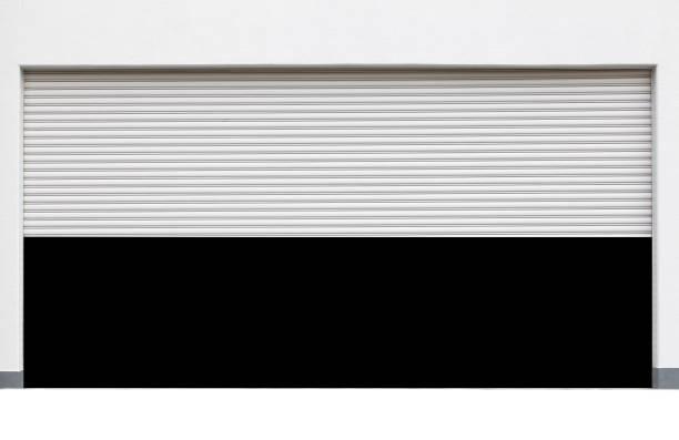 geöffnete weiße rolltor isoliert auf weißem hintergrund - garagentor mit tür stock-fotos und bilder