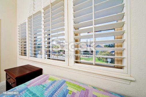 Bedroom window with opened blinds. Super wide 12mm lens on a FF sensor.