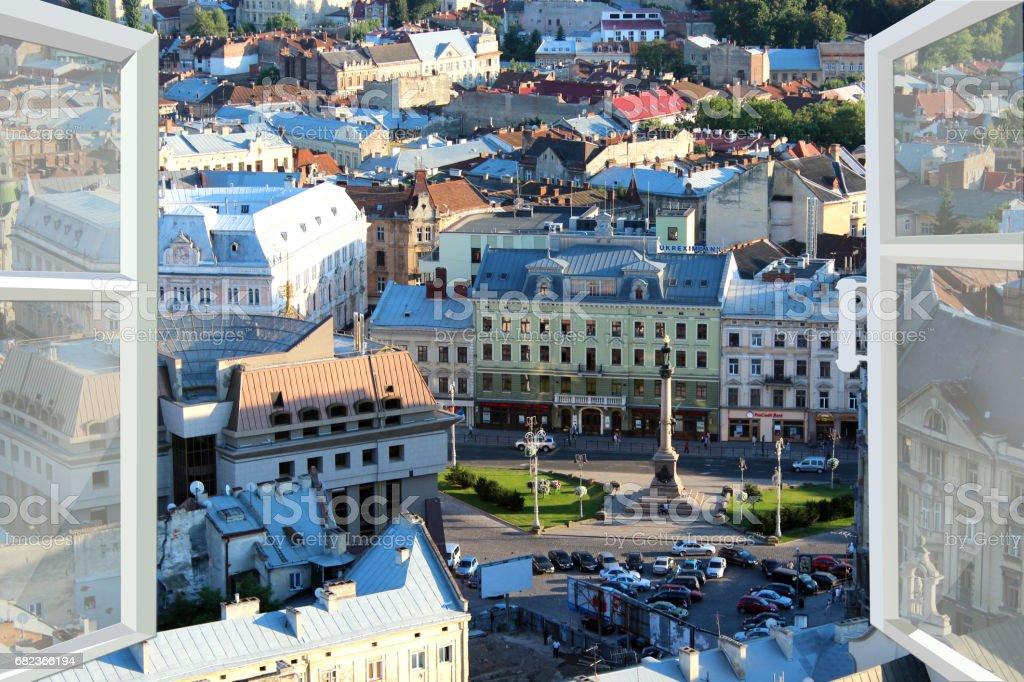 opened window to the roofs of city zbiór zdjęć royalty-free