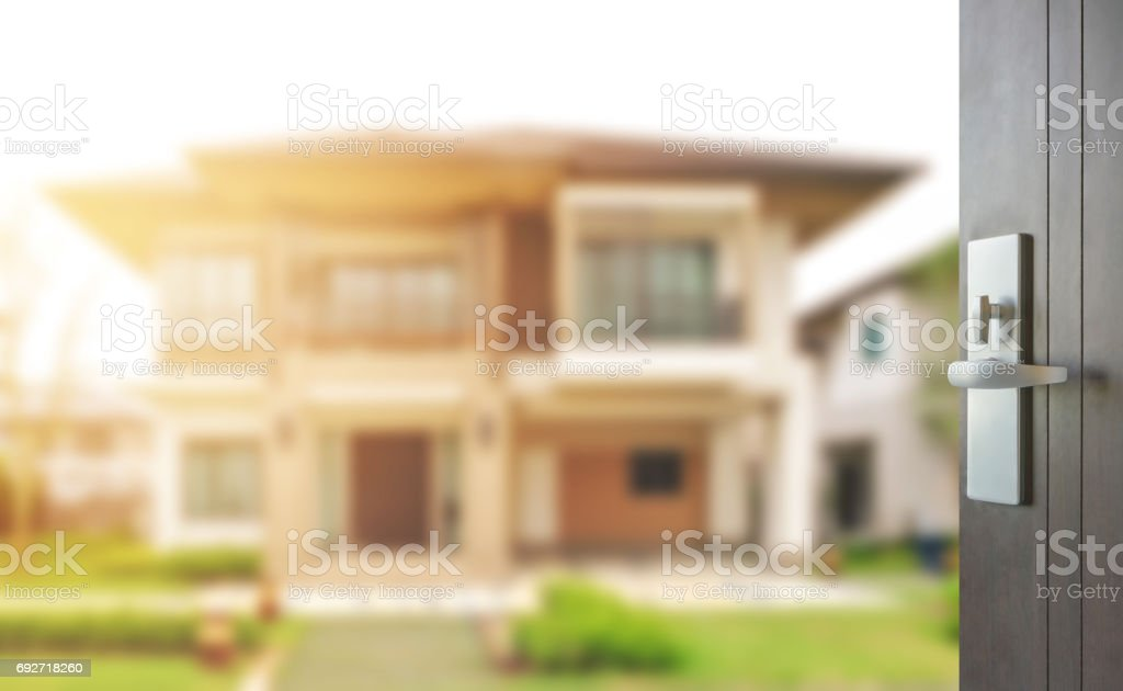 opened wooden door to modern home exterior as background stock photo