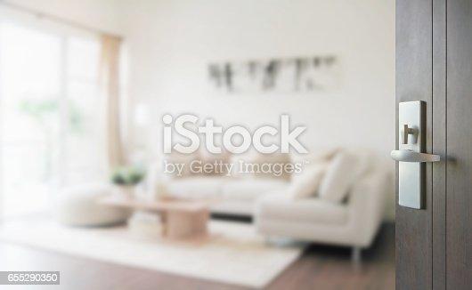 istock opened wooden door to modern living room interior 655290350