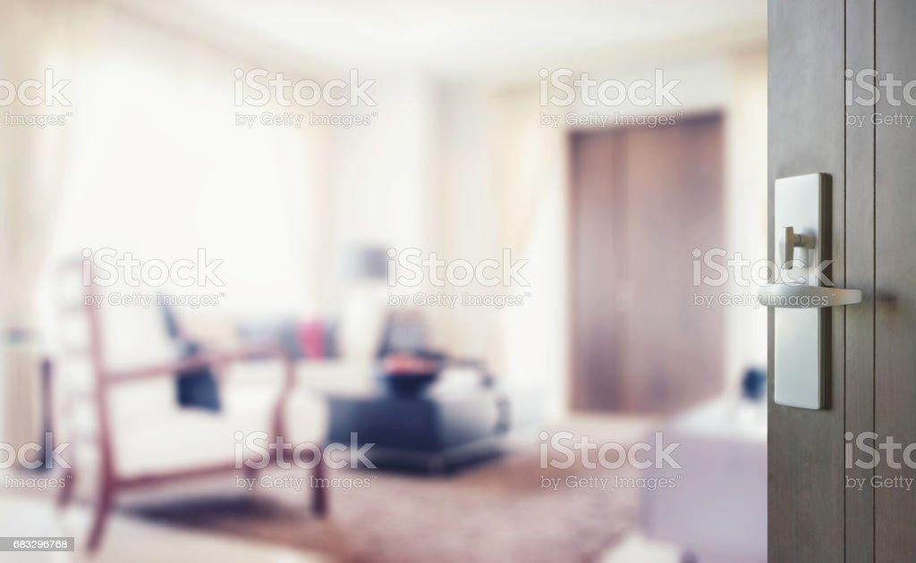 opened wooden door to modern living room interior stock photo
