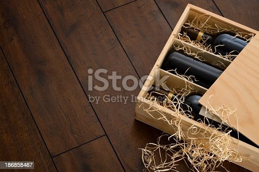 Box of wine on wooden floor.