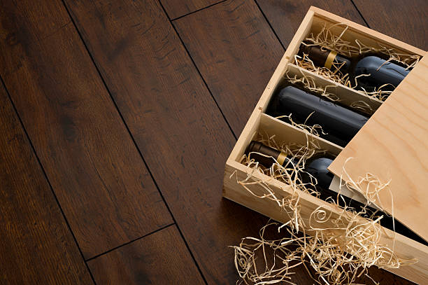 opened wooden wine box packed with wine and straw - wine box bildbanksfoton och bilder