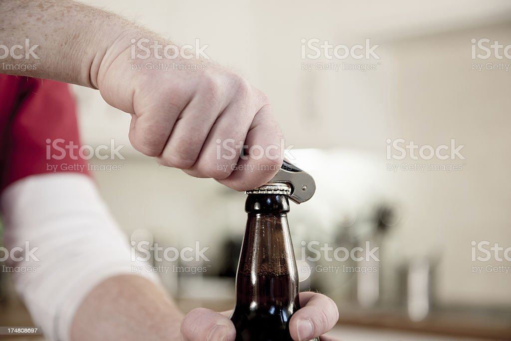 Opening a beer stock photo