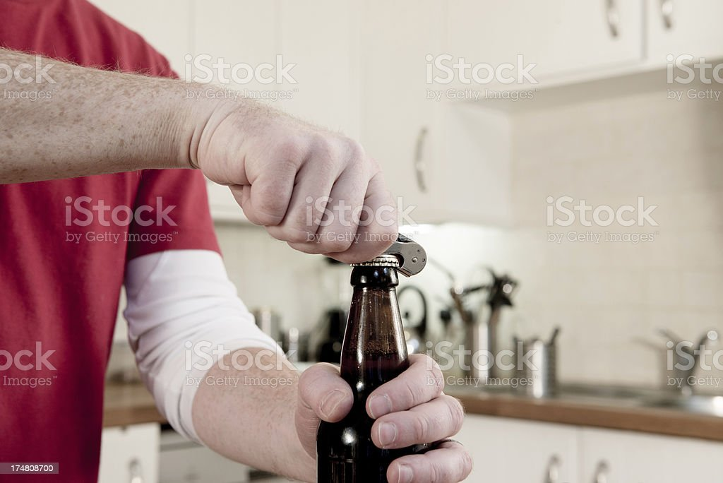 Opening a beer royalty-free stock photo