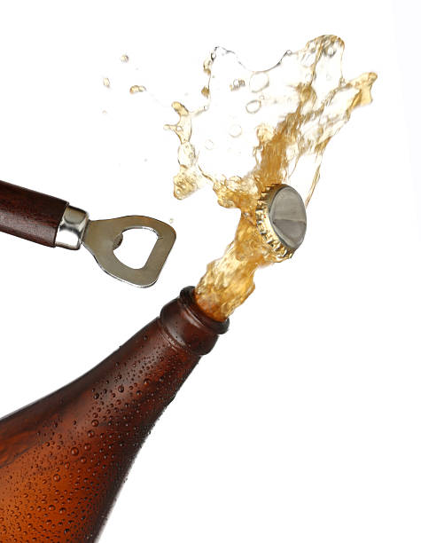 Opening a bottle of cold beer, splash image stock photo