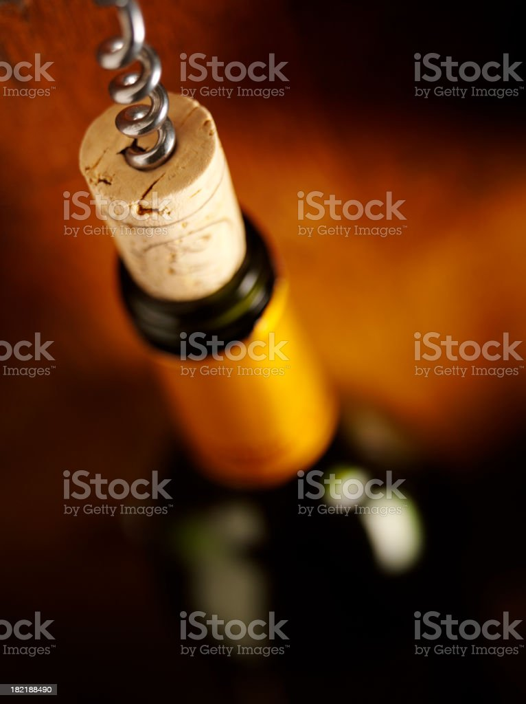 Opening a Bottle of Wine royalty-free stock photo